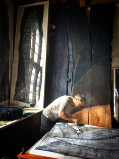 Artist and printmaker Julian Meredith at work in his Herefordshire studio