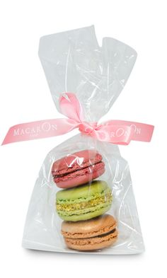 There are no prices on the Macron Paris website only: Contact Laura for details:  laura@macaronparis.com.  I wonder if it will be  cheaper to fly to NYC and buy just one or have these little guys shipped to me?