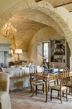 beautiful stone house...Italy - Tuscany - I would love to have my dining room done with a ceiling and arched entrance like this.♥