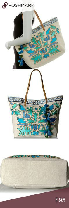 """Steve Madden Boho Wood Beaded Canvas Tote Blue , green and natural    Dual top handles. Snap button tab closure.  Exterior features beaded and embroidered design, faux leather trim, detachable pompom and tassel accent, and back snap button closure pocket.  Interior features 2 wall gusset slip pockets, and 1 zip wall pocket.  Approx. 14.5"""" H x 20.5"""" W x 5.5"""" D.  Approx. 10"""" handle drop.  Cotton/polyester exterior,  PU faux leather trim, polyester lining Steve Madden Bags Totes"""