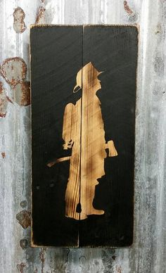 Fireman silhouette which has been burned into reclaimed pallet wood. Each sign will vary slightly because the wood grain burns different in every board. Each sign comes with a wire hanger and is ready to hang.