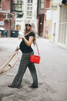 Wide leg light trousers are a perfect summer staple for your pregnancy capsule wardrobe. Offering style and comfort.