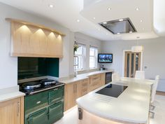 Having already supplied and installed bathrooms for this client, we were asked to totally redesign their kitchen utilising the existing aga and create a dining area. The bespoke canopy for the extractor and lights not only matches the shape of the central island with the attached dining area but has been cleverly designed to overcome the changes in ceiling height and disgiuse the ceiling beam. Designer Adam.Hudson@potts.ltd.uk