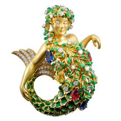 DAVID WEBB Enameled Gold Gem Bearing Mermaid   From a unique collection of vintage brooches at http://www.1stdibs.com/jewelry/brooches/brooches/