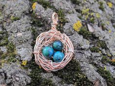 Home Tweet Home Wire Bird's Nest Pendant with Blue and Green Speckled Eggs. $18.00, via Etsy.