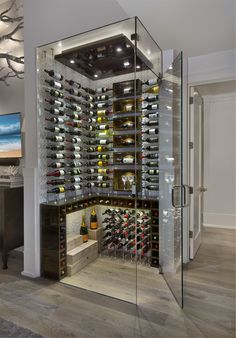 - Love the glass walls and temperature regulated aspect of the cellar - Would want to look more classic and timeless on the inside Glass Wine Cellar, Home Wine Cellars, Wine Cellar Design, Cave A Vin Design, Corner Wine Rack, Corner Wine Cabinet, Wine Cellar Basement, Wine House, Home Bar Designs
