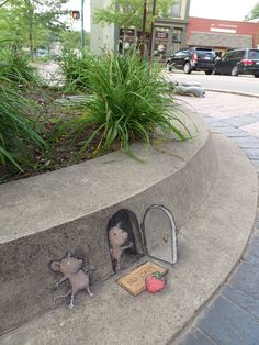 Since 1987, artist and illustrator David Zinn has stalked the streets of Ann Arbor, Michigan, creating temporary illustrations with chalk and charcoal. Zinn improvises each piece on the spot and makes use of found objects, street fixtures, and stairsteps to create trompe l'oeil illusions. These