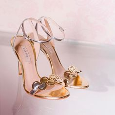 723d2d1b3d59 A sensual sandal that blends the refined shimmer of the glossy metallic  leather