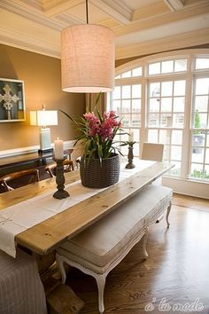 Check out those huge windows and the coffered ceiling.  <3 the bench for a dinning table!