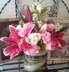 """Fantasy Flowers & More ~ """"Pretty in Pink"""" a design created especially for Breast Cancer awareness month. Lilies, Roses, Mini Carnations, Stock, Snapdragon, Wax flower and Variegated Aspidistra leaf wrap. Design measures approx.12""""W x 14""""H."""