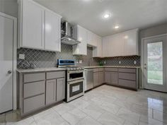 A kitchen that is a cook's dream with high end design, beautiful colors and features, energy efficient appliances, and beautiful tile backsplash with granite countertops 5805 Shoalwood Ave, Austin, TX 78756