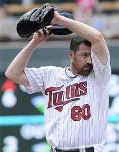 Minnesota Twins pitcher Jeff Gray wipes his brow after giving up a solo home run to Oakland Athletics' Seth Smith in the sixth inning of a baseball game Sunday, July 15, 2012 in Minneapolis.