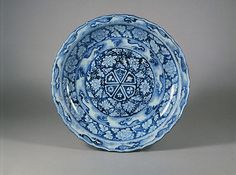 Plate with Peonies and Waves in Reverse Pattern, 14th century, Yuan dynasty (1271–1368), China. Porcelain with underglaze cobalt blue...