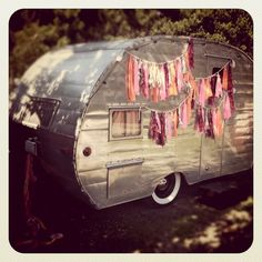 Love the whitewalls and the gypsy flags-- and looks like my new camper!