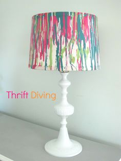 Spray painted lamp shade, with a hookah as the base, spray painted bright white.