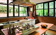 The aluminum windows were painted to resemble wrought iron. Different materials on kitchen counters,marble,wood,steel for different jobs and far more interesting.