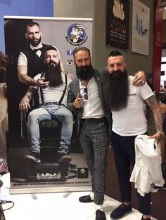 Image may contain: 4 people, beard, shoes and indoor