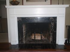 Fireplace surround with raised hearth black marble | Granite ...