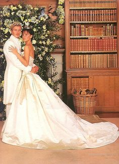 David and Victoria Beckham in a strapless Vera Wang wedding dress www.AmosEvents.com