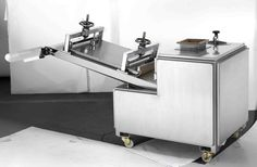 Long rolling and moulding machine for bread processing line.