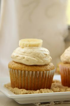 Banana Cupcakes with a Whipped Brown Sugar Buttercream. You HAVE to try this frosting... I still can't get over how good it was!