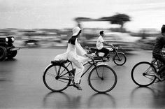 Girl on Bicycle, Saigon, Raymond Depardon. Silver gelatin print and White Bike Photography, Minimal Photography, Photography Workshops, Black And White Photography, Nature Photography, Advanced Photography, Photography Composition, Photography Ideas, Saul Leiter