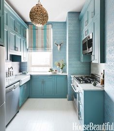 Fun New York City kitchen in turquoise by Sheila Bridges Design. Cabinets are painted Benjamin Moore Hemlock. Shimmery wallpaper is Torino Damask by Sheila Bridges. Photo: Annie Schlechter.