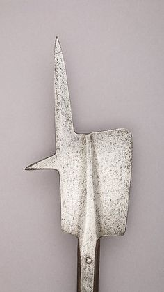 Halberd | Swiss | The Met Date:possibly mid–15th century Culture:Swiss Medium:Steel, wood (oak) Dimensions:L. 80 3/4 in. (205 cm); L. of head 14 1/8 in. (35.8 cm); W. 7 5/8 in. (19.4 cm); Wt. 5 lbs. 8 oz. (2490 g) Classification:Shafted Weapons Credit Line:Gift of Alan Rutherfurd Stuyvesant, 1952 Accession Number:52.208.8