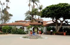 The stunning entrance of the historic Casa Romantica Cultural Center and Gardens in San Clemente, CA. Original Spanish tiles, red tile roof, ocean views, well-tended gardens. The perfect spot for a wedding or event or just a simple stroll while learning some of the rich history of our city.