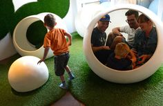 Description of . DENVER, CO - MARCH 22: Daniel Tracy, of Loveland, in white shirt and glasses, sits inside one of the bubbles with his wife Megan, right, and son Liam, 5, and friend Adam Harris in the Bubble Garden at the Museum of Contemporary Art in  Denver, CO on March 22, 2015. At left is Tracy's other son Jack, 4.  The MCA Denver partnered with architect Paul Anderson of Indie Architecture to create the Bubble Garden, an otherworldly landscape of large plastic spheres (or bubbles) and…
