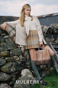 The model sports her own Cara bag collection, as well as other styles, alongside the company's ready-to-wear in the images.