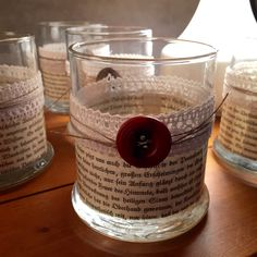 Shabby chic votive candle holder, lace ribbon, old button, hemp string, pages torn from an old German book and applied with mod podge. Would love to try making something similar with pages from an old Bible.  Repurposed and upcycled.