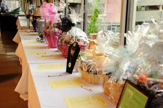 Clean/organized set up for a silent auction.  Print bid sheets on colored paper to match table color/closing times.