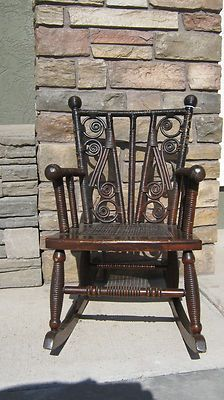 Vintage hand crafted dark red rocking chairs is made out of bentwood. This rocking chair is in great condition and sturdy enough for a child or would be a beautiful piece to display your show case doll.