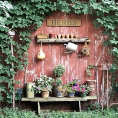 A little area like this would look lovely down the side of the kitchen. Herbs in pots, attractive watering cans, could put the potting bench there too...