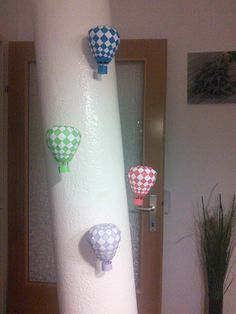 I used a paperclip and a magnet to hang them on this metal pole. Air Balloon, Balloons, Metal Pole, Paper Clip, Toilet Paper, Magnets, Balloon, Toilet Paper Rolls