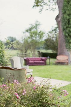 Outdoor seating area with retro chairs & sofas - Image by Craig & Eva Sanders Photography - Bride in a Bespoke Gown with Gold Christian Louboutin Shoes, for an outdoor humanist ceremony in Wales with pastel colour scheme & copper hints.