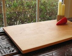 Cherry wood serving tray with feet - $55.00  I just love the simplicity of this.