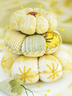 With patchwork and decorative stitching, pincushions never looked so good. Corral a few favorite fabric scraps and start stitching.