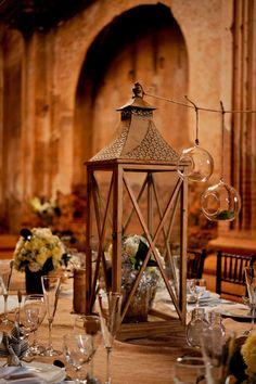 lantern centerpiece - love this old brown one