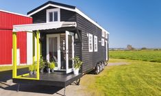This is a custom, triple axle tiny home on wheels by Tiny Living Homes. From the outside, you'll notice it's relatively large for a tiny house on a trailer. When you go inside, you&#821…