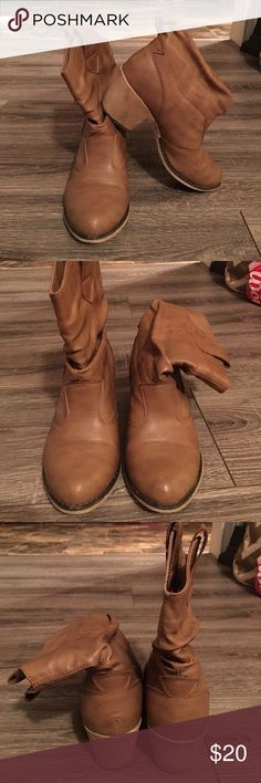 "Brown Ankle Booties Brown Ankle Booties- Size 6: EUC. These western inspired booties are a must for any wardrobe. They have a low stacked heel and side tabs for easy pulling on and off of the boots. The heel is 2.5"" tall, the boot height is 8"" , and the boot opening circumference is 12"". These are a reposh due to being to small as a Christmas present- otherwise we would keep them😍 They come from a smoke free home. Shoes Ankle Boots & Booties"