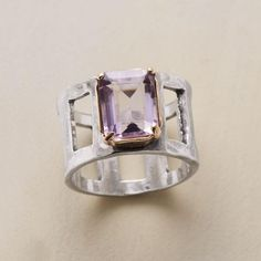 """CLERESTORY AMETHYST RING--Framed in 14kt gold, pale amethyst shines on a windowpane band of hammered sterling silver. Exclusively for Sundance. Hand cast. Whole sizes 5 to 9. 1/2""""W."""