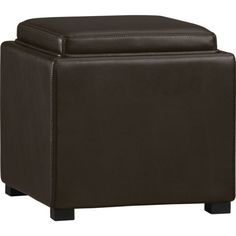 It doesn't have to be this but we like this type of ottoman for our family room; double as a coffee table if we put a few together.