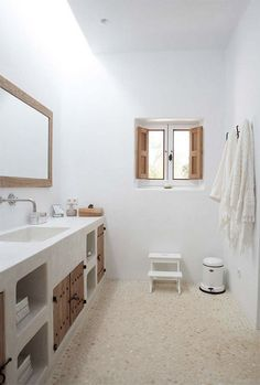 Can Xicu, Ibiza. Design by Blakstad Pebble floors, shutters, natural light, simple, clean design.