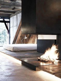 Open fireplace in bedroom