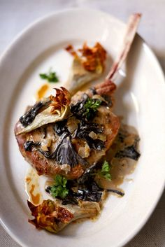 Veal chops with black trumpet mushrooms and artichokes