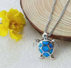 This elegant sea turtle pendant is crafted in fire opal and set in sterling silver. A perfect gift item for the sea turtle lover in your life. PENDANT DETAILS - Pendant size: .79 inch x 1 inch - Chain