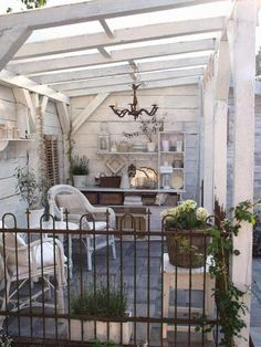 .What a gorgeous shabby chic outdoor space! Love the walls, the flooring and the roof. I could enjoy a nice glass of wine out here. #shabbychic #shabbychicoutdoorspace