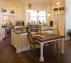 peregrine homes designed this kitchen to have an old country feel with all white cabinets - Kitchen Island With Table Attached